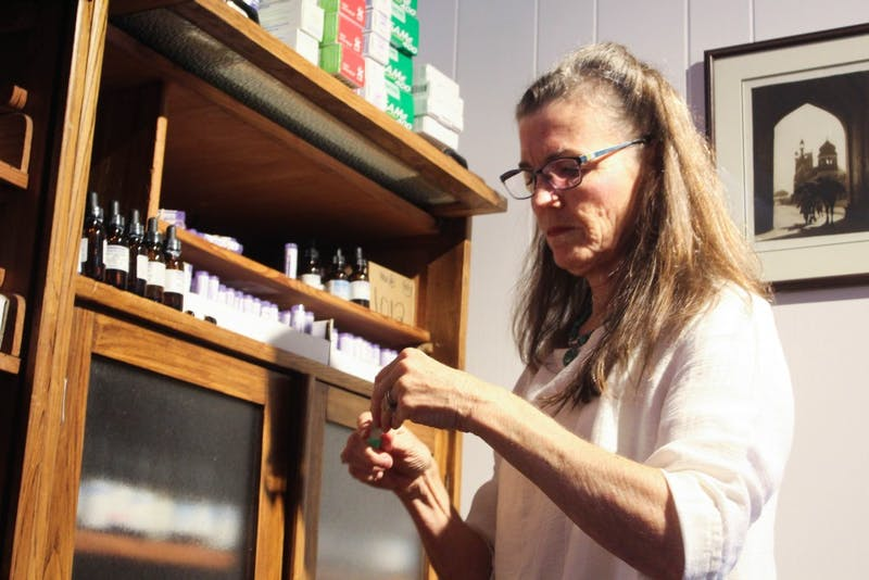 Chapel Hill resident Dr. Susan DeLaney, 66, working in her office on Oct. 5 at The Wellness Alliance in Carrboro. Delaney is a naturopathic general practitioner and uses natural medicines to treat various ailments.