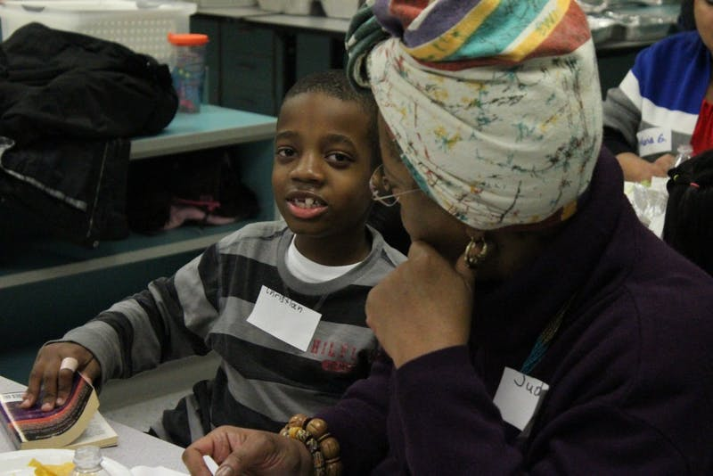 Christian and his mom talk get ready to read during McDougle Elementary School's first Family Reading Partners program event.