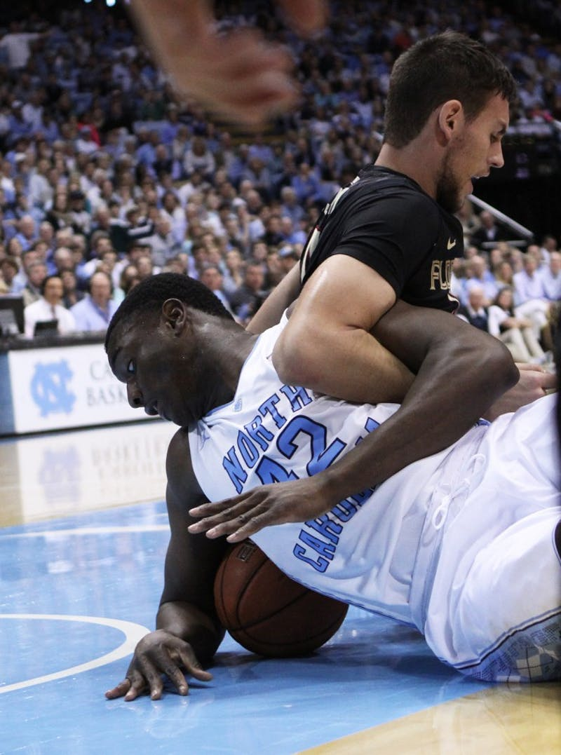 UNC forward Joel James (42) and Florida State center Boris Bojanovsky (15) wrestle for the ball.