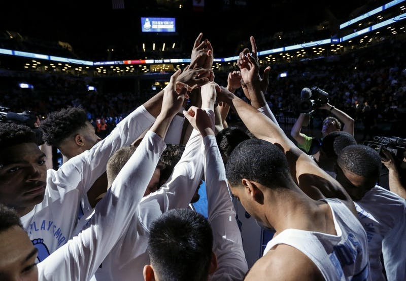 The North Carolina men's basketball team huddles before its ACC Tournament game against Syracuse on Wednesday night in Brooklyn, New York. Photo courtesy of David Welker, theACC.com