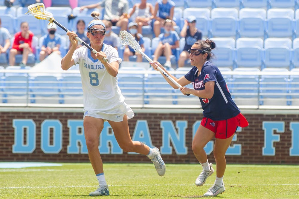UNC redshirt-senior attacker Katie Hoeg (8) runs with the ball at the quarterfinals of the NCAA tournament against Stony Brook at the Dorrance Field in Chapel Hill on Saturday May 22, 2021. The Tar Heels won 14-11.