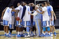 The team huddles at center court to end the practice. The UNC men's basketball team held an open practice at the AT&T Center in San Antonio on Thursday. The Tar Heels will face Providence in the second round of the NCAA tournament on Friday.