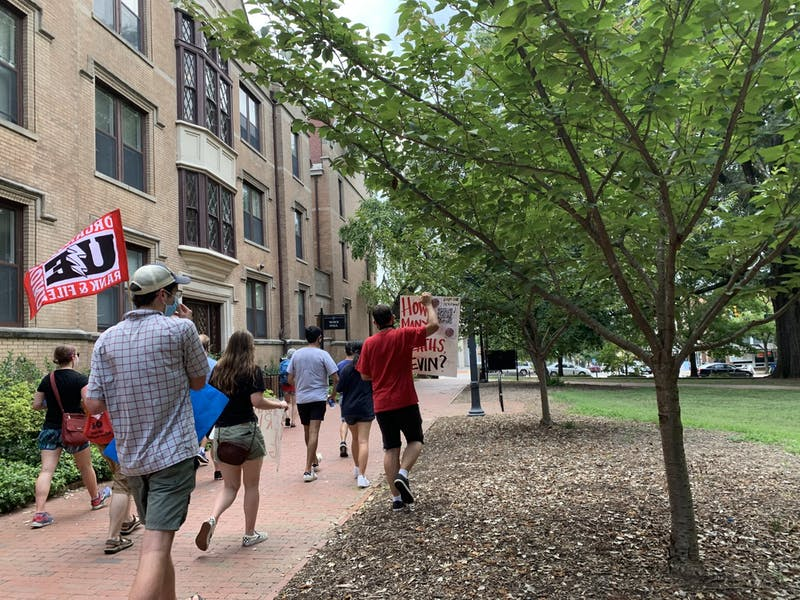 UNC System workers march across campus towards South Building on Friday, July 17, 2020 to protest the university's approach to reopening.