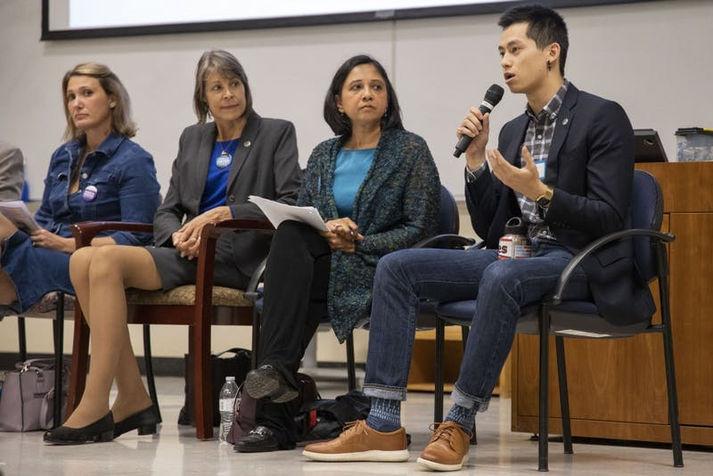 Chapel Hill Town Council candidate Tai Huynh (far right) speaks at the UNC Young Democrats' Local Candidates Panel in Manning Hall on Tuesday, Oct. 8, 2019. Also pictured are council candidates Jessica Anderson (far left), Nancy Oates (center left), and Renuka Soll (center right).