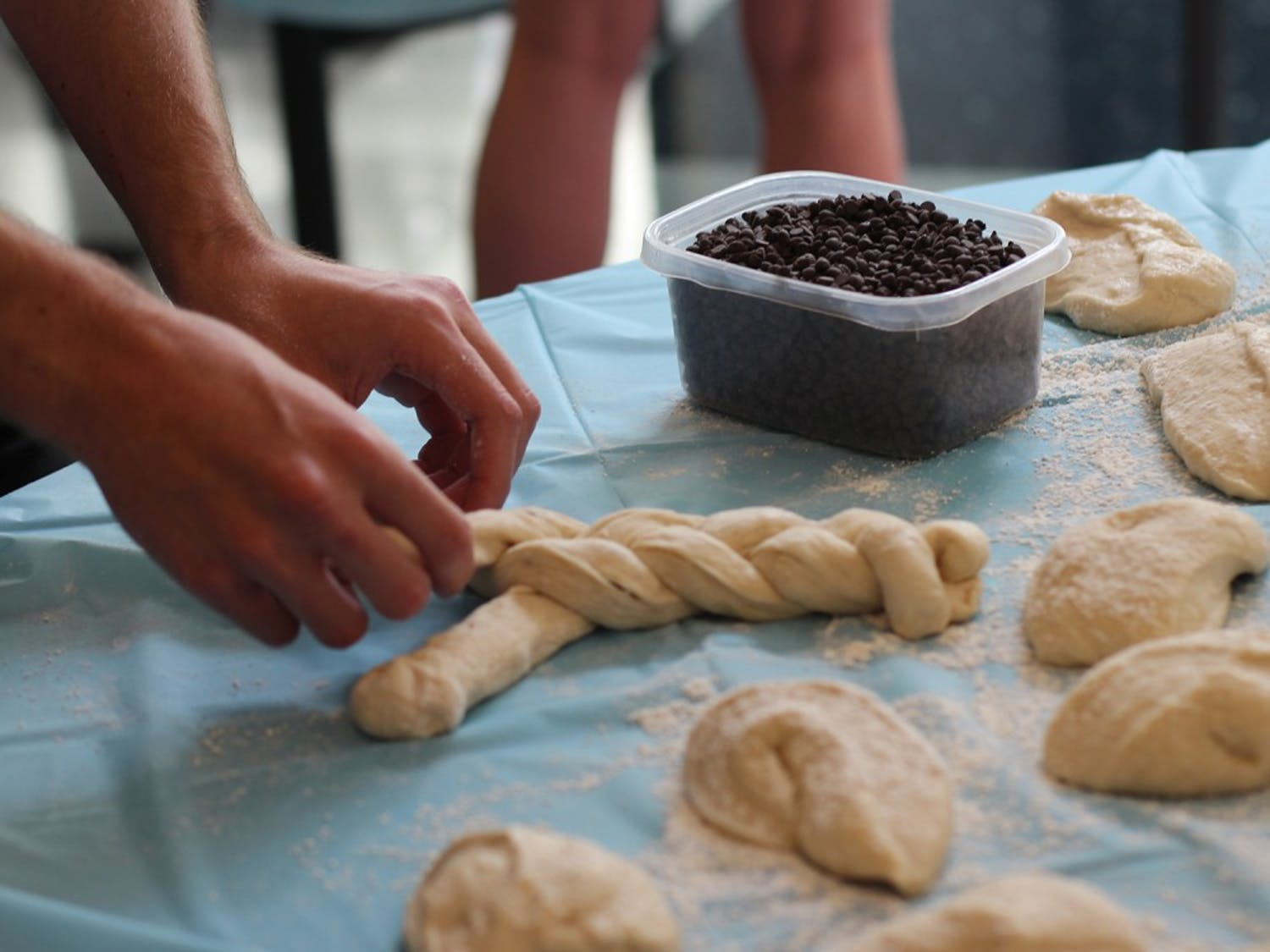 Students weave dough for the Challah for Hunger bake sale. Challah is a traditional Jewish bread eaten on Sabbath and holidays.