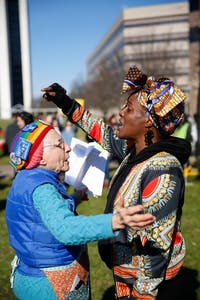 Two women at the 2019 Raleigh Women's March converse about the role of diversity in women's rights movements on Halifax Mall Saturday, Jan. 26, 2019.