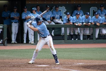 First-year catcher Eric Grintz prepares to swing for his fourth hit of the game, a 2-run double in the 8th inning of the Diamond Heels' 7-1 win over Elon Tuesday, Feb.18, 2020.