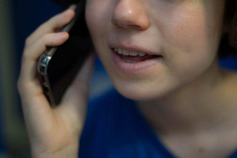DTH Photo Illustration depicting a student speaking on the phone with an elderly member of the community through Online Elderly Companionship, an organization led by UNC students.