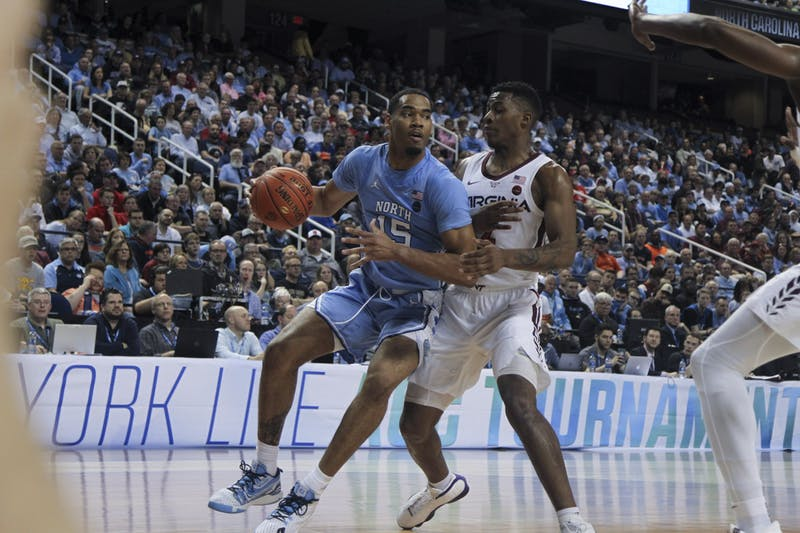 Junior forward Garrison Brooks (15) looks to pass during the first-round game of the ACC tournament against Virginia Tech in the Greensboro Coliseum Complex on Tuesday, March 10, 2020. UNC beat Virginia Tech 78-56.