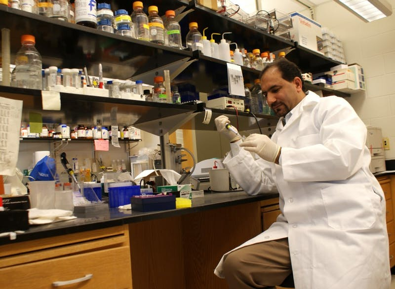 Manzoor Bhat works in his lab in the Neuroscience Center in 2011.