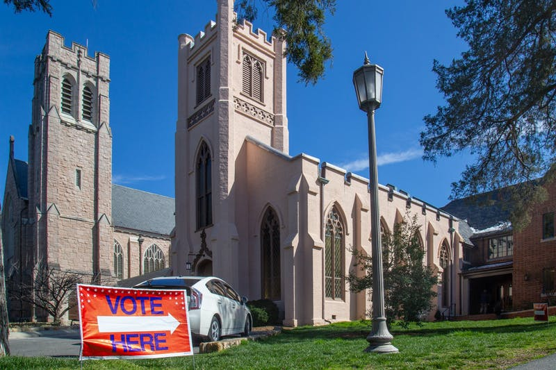 A sign directs voters to Chapel of the Cross where primary early voting is held on Sunday, Feb. 23, 2020.