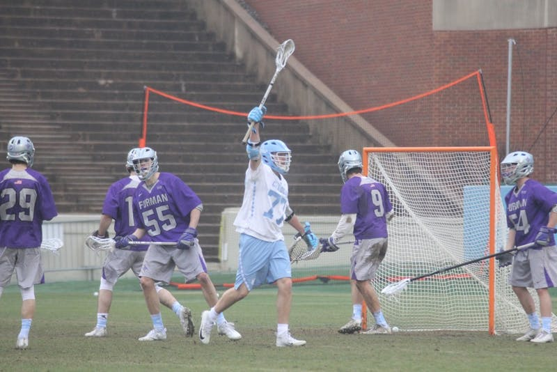 Midfielder Tanner Cook (77) celebrates a goal against Furman on Feb. 10 in Kenan Stadium.