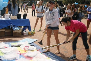 Amanda Roth (left) and Emili Hall, juniors, participate in Southern Smash on Monday. Theevent was hosted by UNC Panhellenic Council near Davis Library.