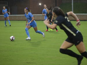 UNC senior defender and midfielder Emily Fox (11) runs with the ball during the game against Wake Forest at Dorrance Field on Thursday, Sep. 17, 2020. UNC defeated Wake Forest 4-1. Two of the goals were scored by junior forward Brianna Pinto (8) and the other two by junior forward Rachel Jones (10).