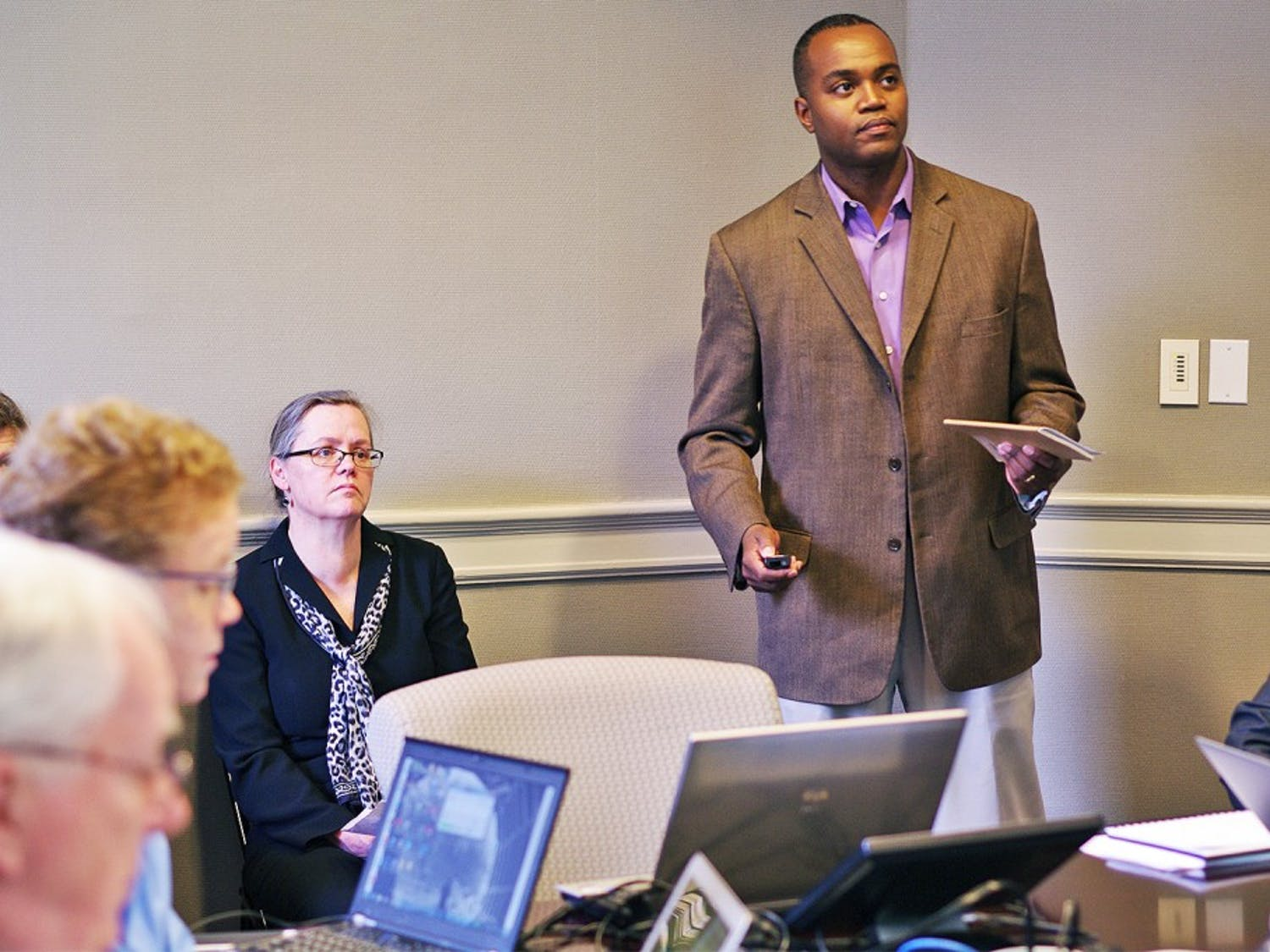 Associate Professor at North Carolina Central University Antonio Baines (right), speaks at the Faculty Executive meeting on Monday.