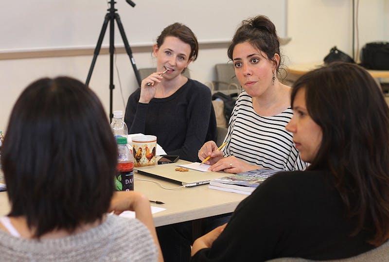 Kristen Sieh, Rachel Chaukin and Jessica Almasy were taught Mandarin by Kim Satterfield Monday.
