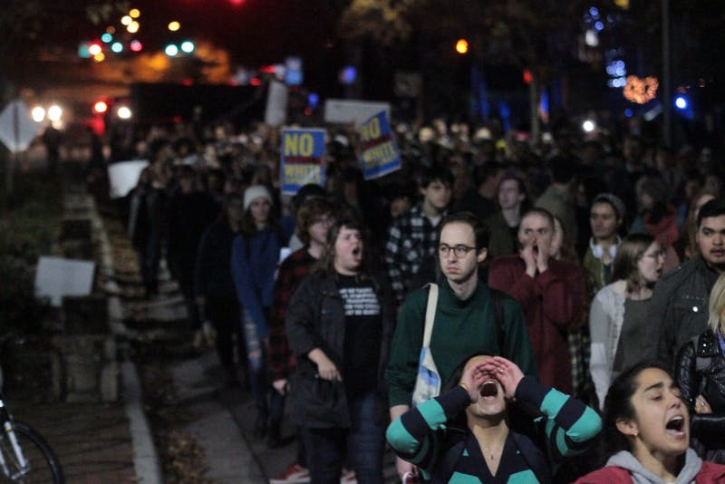 Demonstrators march and chant on Cameron Ave after the decision to move Silent Sam to a new historic center on campus was announced on Monday, Dec. 3, 2018.