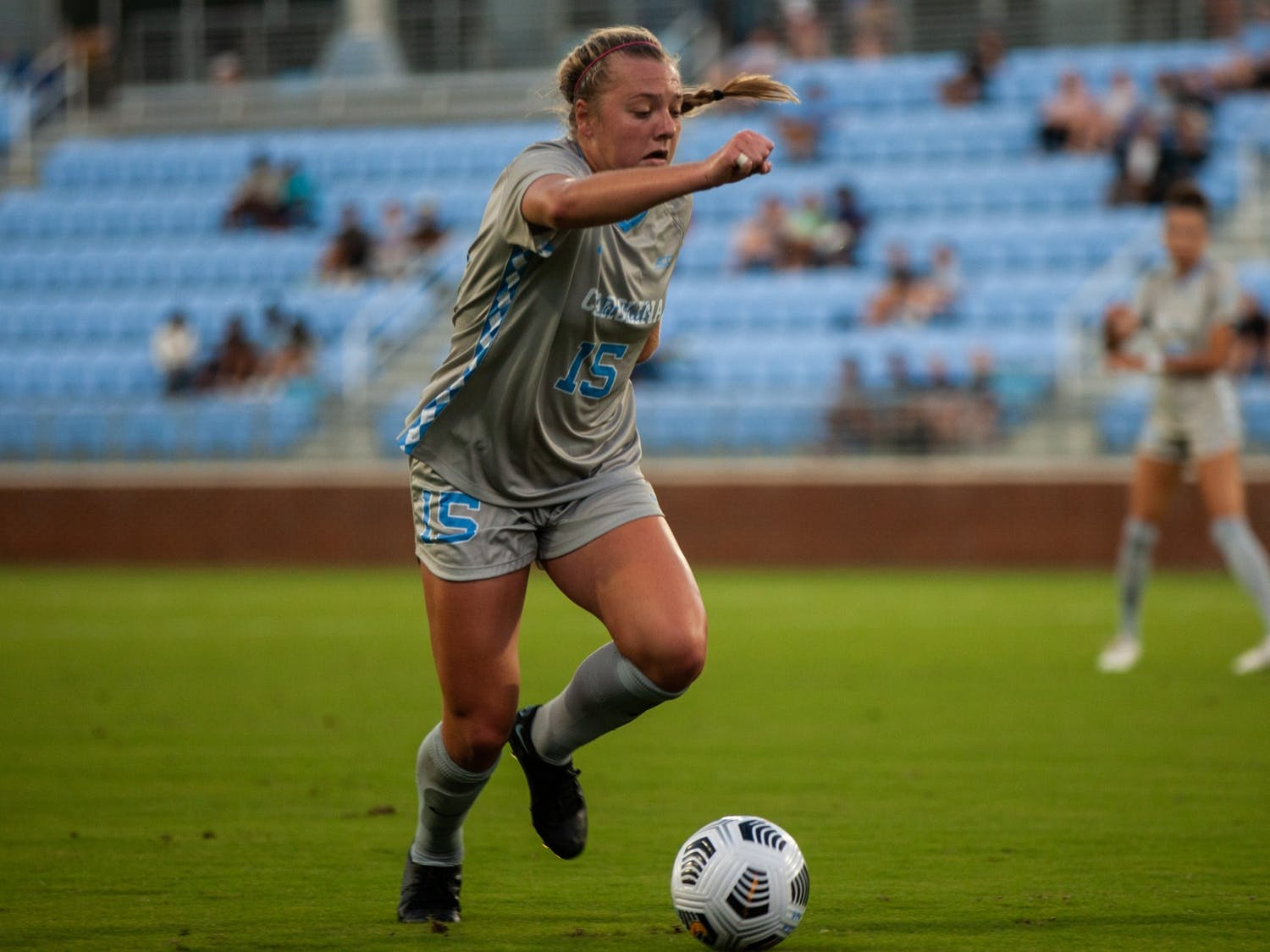 Sophomore forward/midfielder Avery Patterson (15) gears up to kick the ball down the field at the home game against Northwestern on Sept 2. UNC won 2-0.