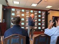 UNC football head coach Mack Brown conducts a press conference on early signing day in the Kenan Football Center.