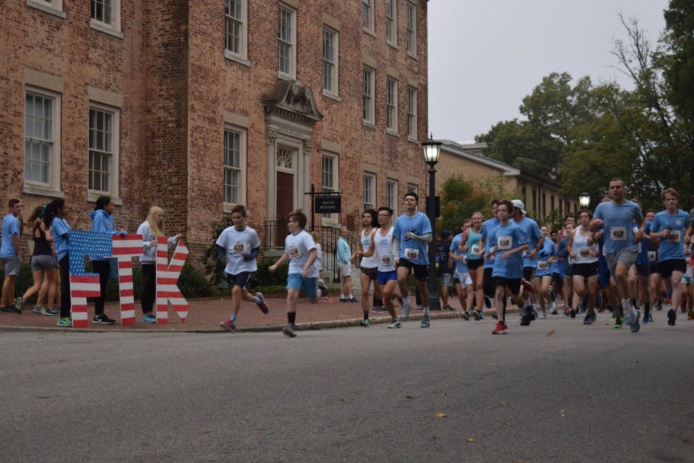 <p>Two young runners sprint away from the starting line and lead the pack of runners during the Carolina for the Kids annual 5K and Fun Run on Sunday.</p>