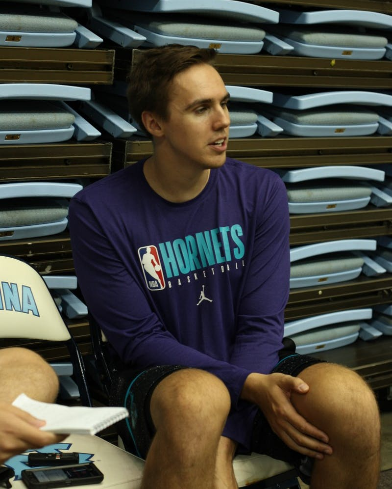 Former UNC Basketball forward and current Charlotte Hornets Assistant Video Coordinator Jackson Simmons is interviewed during Hornets training camp being held in the Dean E. Smith Center on Friday, Oct. 4, 2019.
