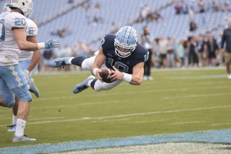First-year quarterback Jace Ruder (10) dives into the end zone for a touchdown during the spring football game in Kenan Memorial Stadium on April 13, 2019.
