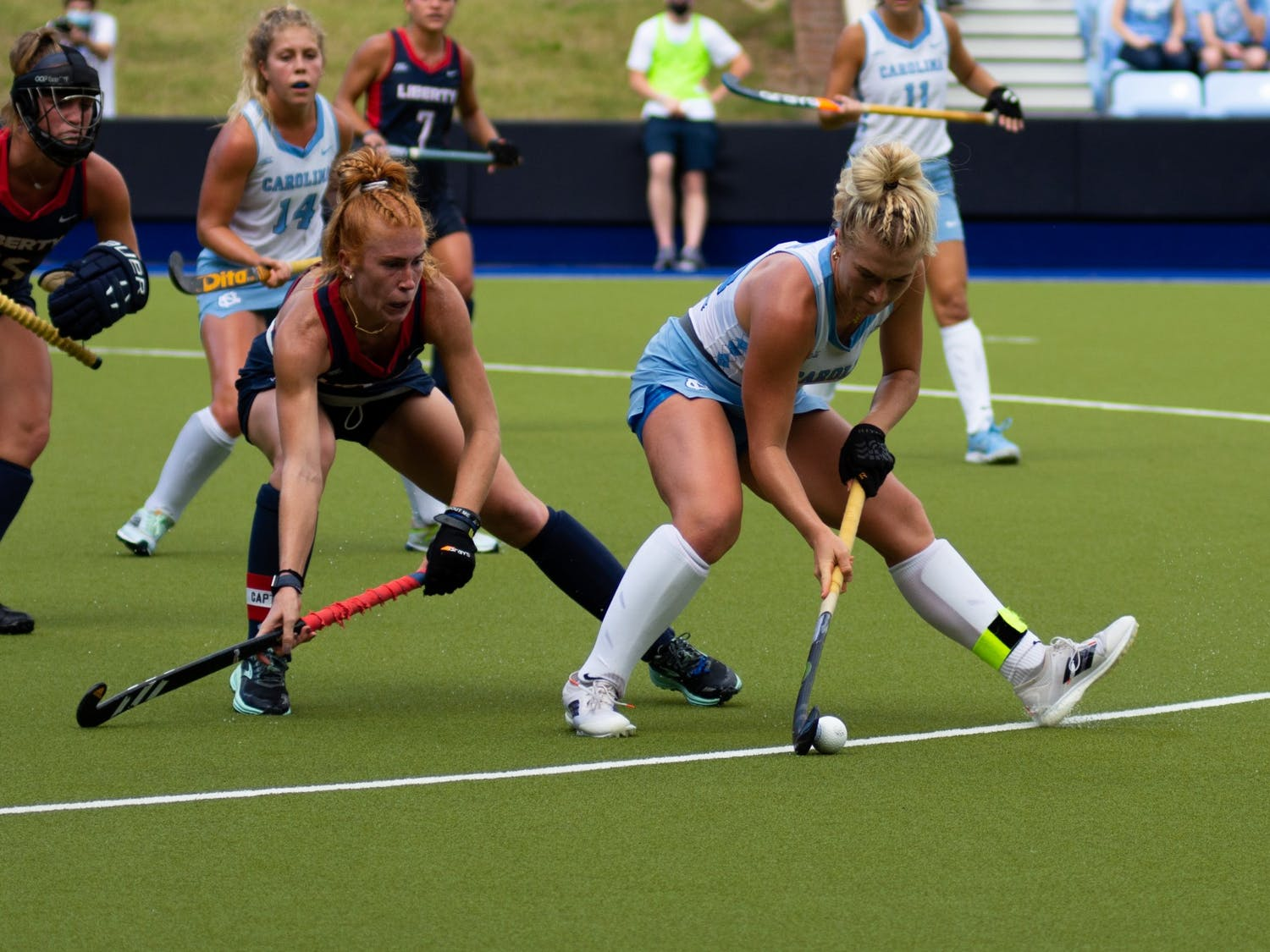 Senior midfielder Cassie Sumfest (12) defends the ball during UNC's Oct. 10 field hockey game against Liberty. The game proved to be a loss for the Tar Heels–Liberty headed home with a 4-0 win.