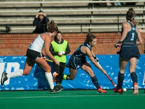 Senior midfielder Yentl Leemans (18) hits the ball in the championship game against Princeton on Sunday, Nov. 24, 2019. UNC beat Princeton 6-1, finishing the year 23-0 and claiming their eighth national title.