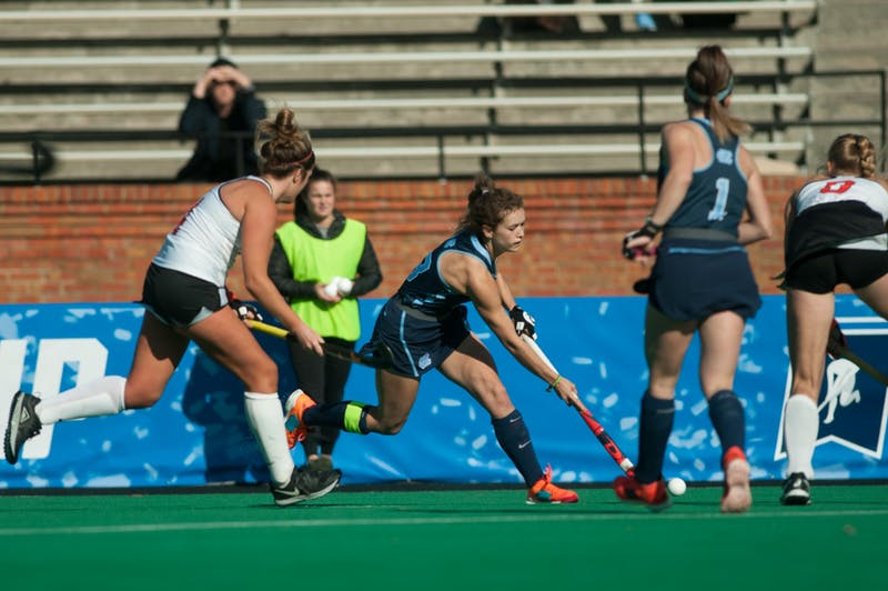 Senior midfielder Yentl Leemans (18) hits the ball in the championship game against Princeton on Wednesday, Nov. 24, 2019. UNC beat Princeton 6-1.