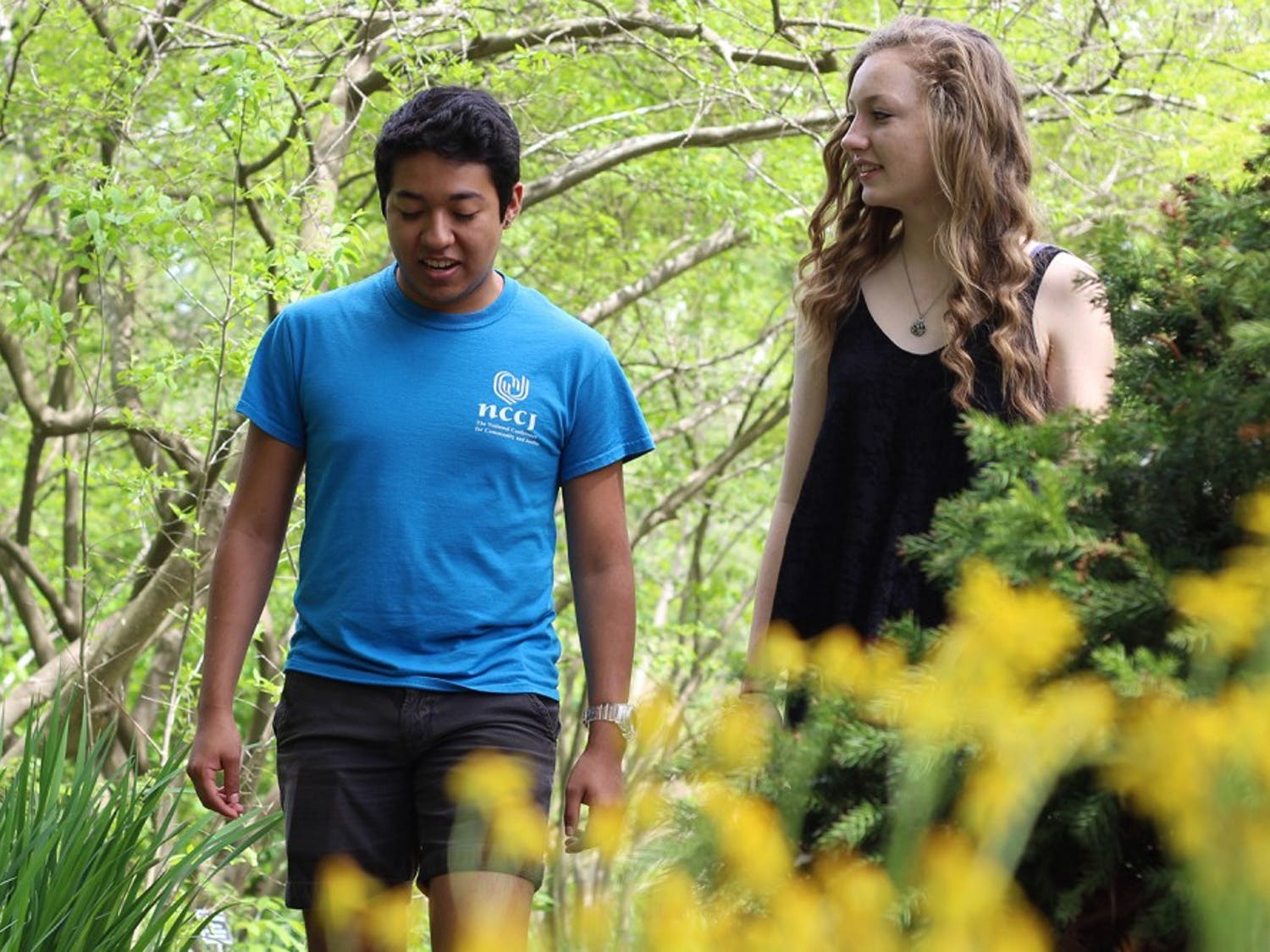 UNC-CH freshmen Cesar Rodriguez and Alex Blackburn walk through the Coker Arboretum Monday. They were close friends with Anna Smith.