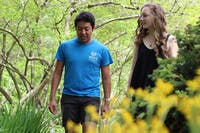 UNC-CH freshmen Cesar Rodriguez and Alex Blackburn walk through the Coker Arboretum Monday. They were close friends with Anna Smith.
