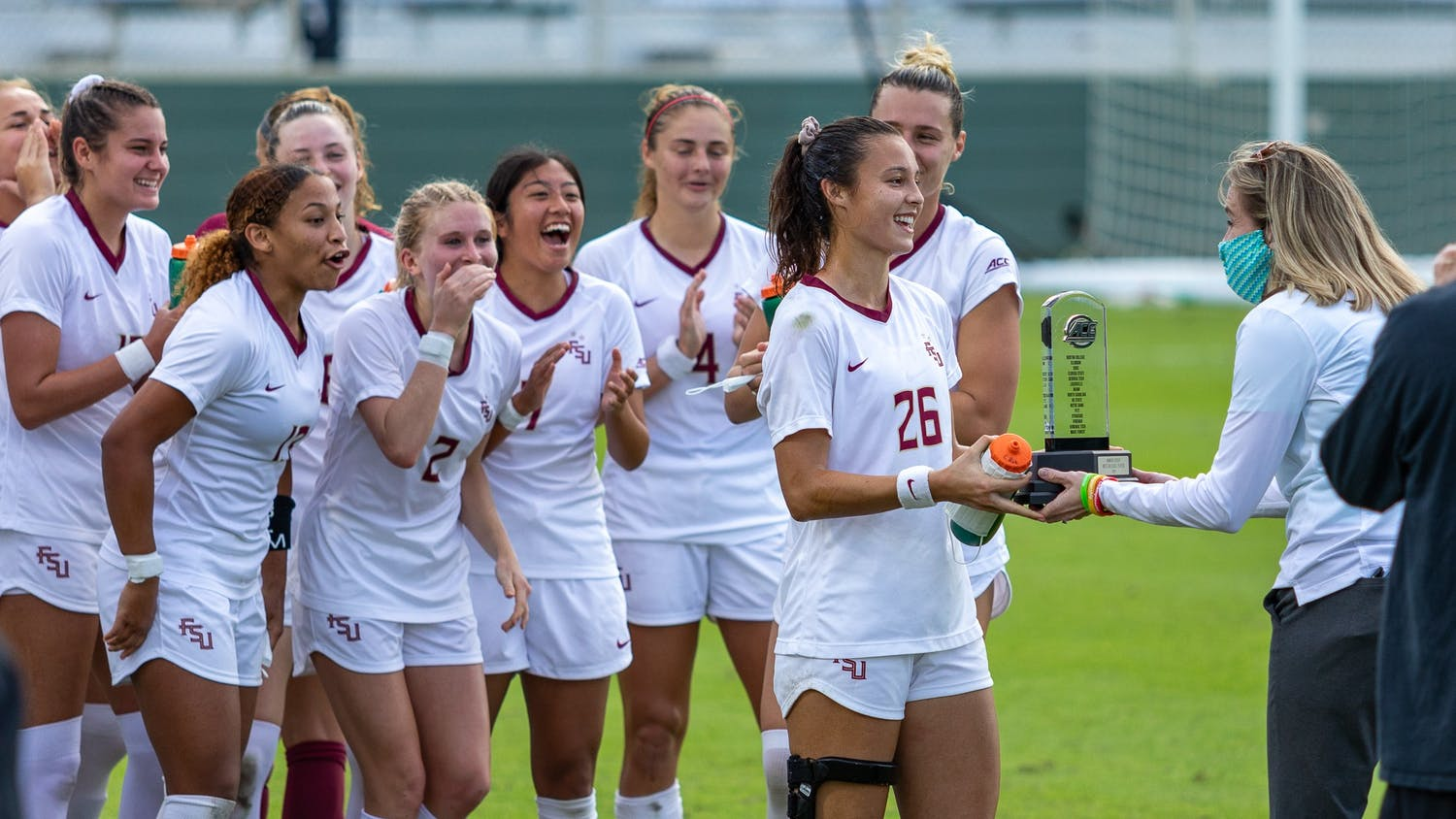 FSU redshirt senior defender Clara Robbins (26) receives the MVP trophy in Sahlen's Stadium in Cary, NC on Nov. 15, 2020. The Seminoles beat the Tar Heels 3-2 to win the ACC championship.