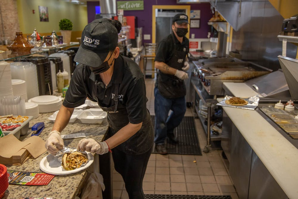 <p>Zaina Haj Ali of Jed's Kitchen prepares an online order on Wednesday, March 3, 2021. The Moroccan and Meditteranean grill opened in December on Franklin Street.</p>