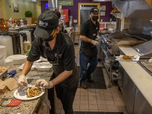 Zaina Haj Ali of Jed's Kitchen prepares an online order on Wednesday, March 3, 2021. The Moroccan and Meditteranean grill opened in December on Franklin Street.