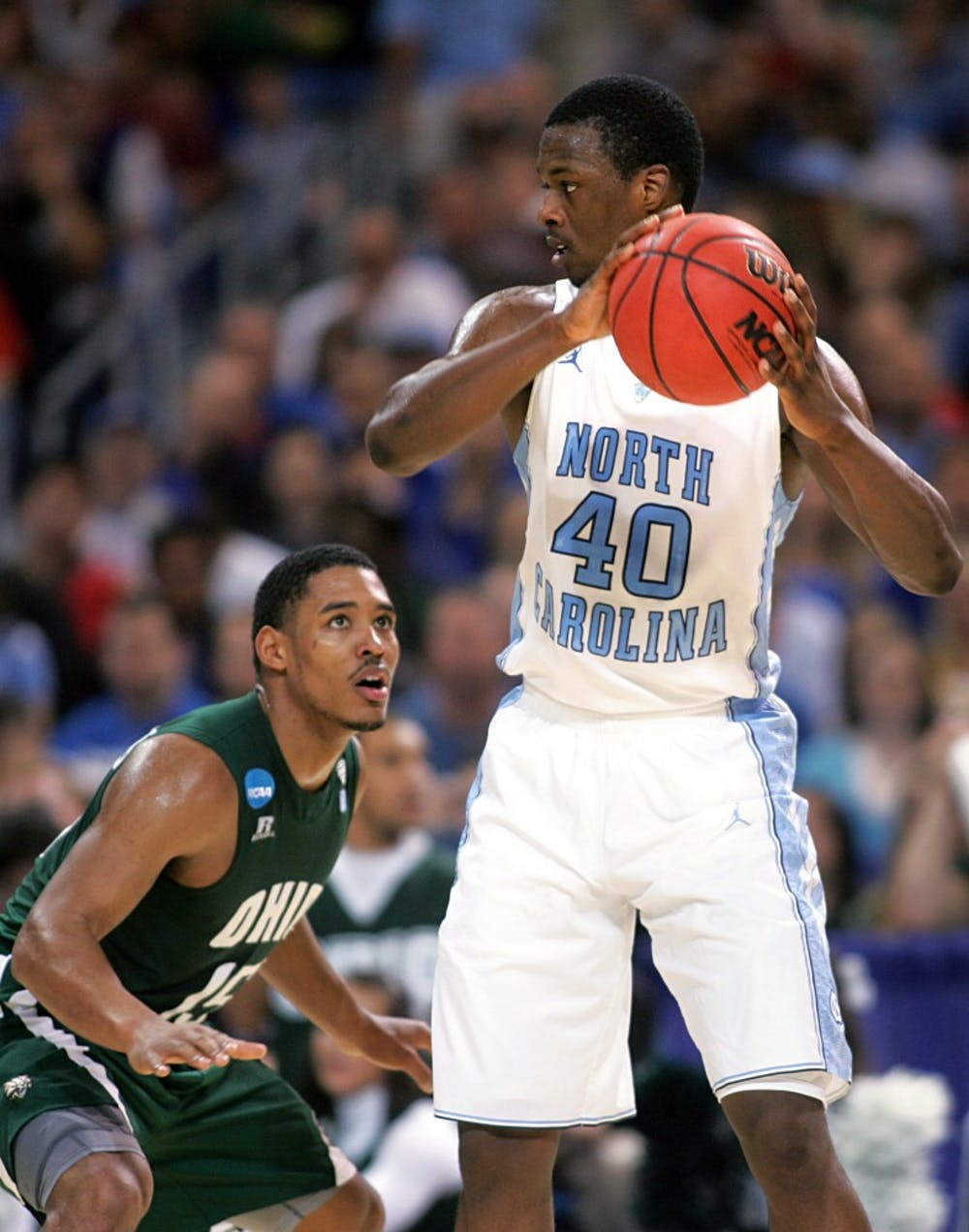 <p>UNC forward Harrison Barnes is defended by Ohio guard Nick Kellogg. Barnes scored 12 points in the Tar Heels 73-65 overtime win over Ohio on Friday, March 23, 2012 in the Sweet 16 round of the NCAA Tournament at the Edward Jones Dome in St. Louis.&nbsp;</p>