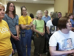 Community members gather to protest the practices and treatment of Kira Fisher by Ellers Capital Partners on June 11.