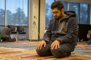 UNC sophomore Zeshan Bari prays during the UNC Muslim Students Association's weekly prayer held every Friday in the Student Union annex.