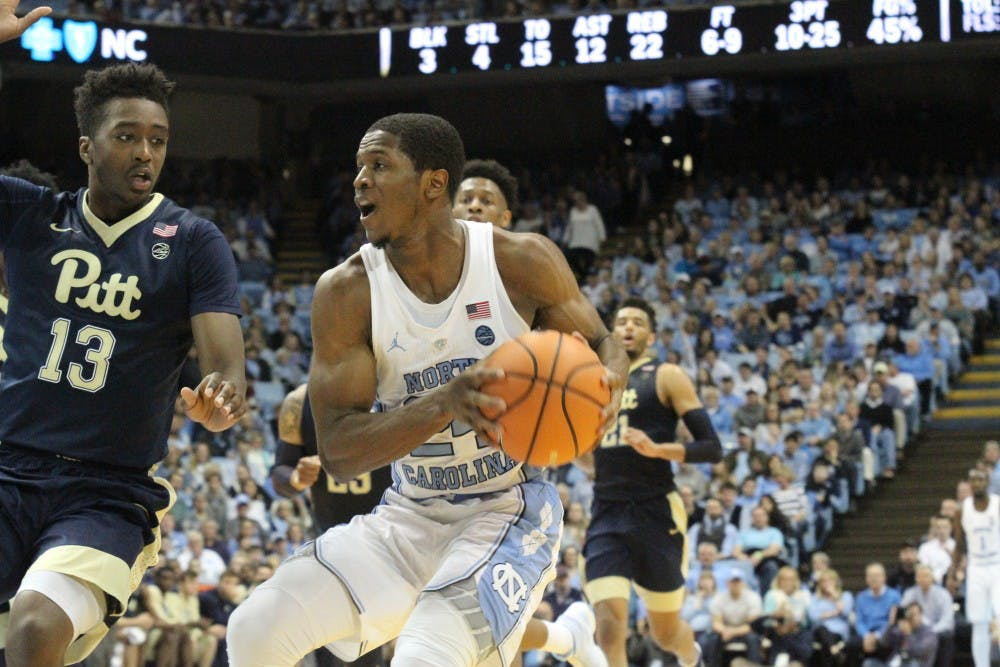 <p>Guard Kenny Williams (24) drives to the basket against Pittsburgh on Feb. 3 in the Smith Center.</p>