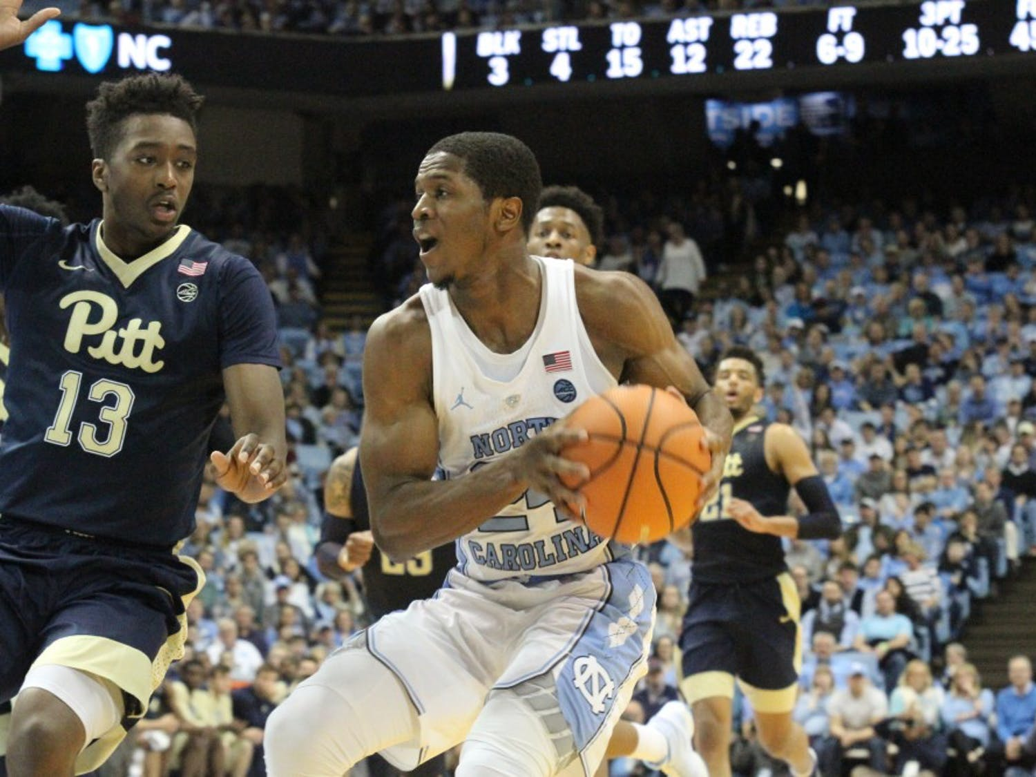 Guard Kenny Williams (24) drives to the basket against Pittsburgh on Feb. 3 in the Smith Center.