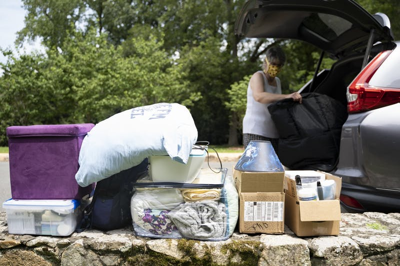 Becca Redding, mother of UNC sophomore Elizabeth Redding, unloads bags from the car on Wednesday, Aug. 5, 2020 as Elizabeth moves into her dorm in Kenan Residence Hall.