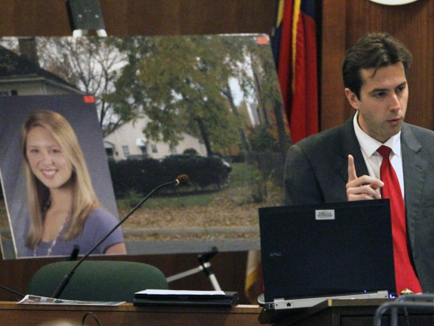 Orange Co. assistant DA James Rainsford, right, begins closing arguments for the prosecution before the jury Monday, Dec. 1, 2011 in the kidnap, robbery and murder trial of defendant Laurence Alvin Lovette, 21, of Durham. At left are two enlarged prosecution photos, one of UNC student body president Eve Carson, who was murdered on March 5, 2008. Lovette is one of two men charged in Carson's death.