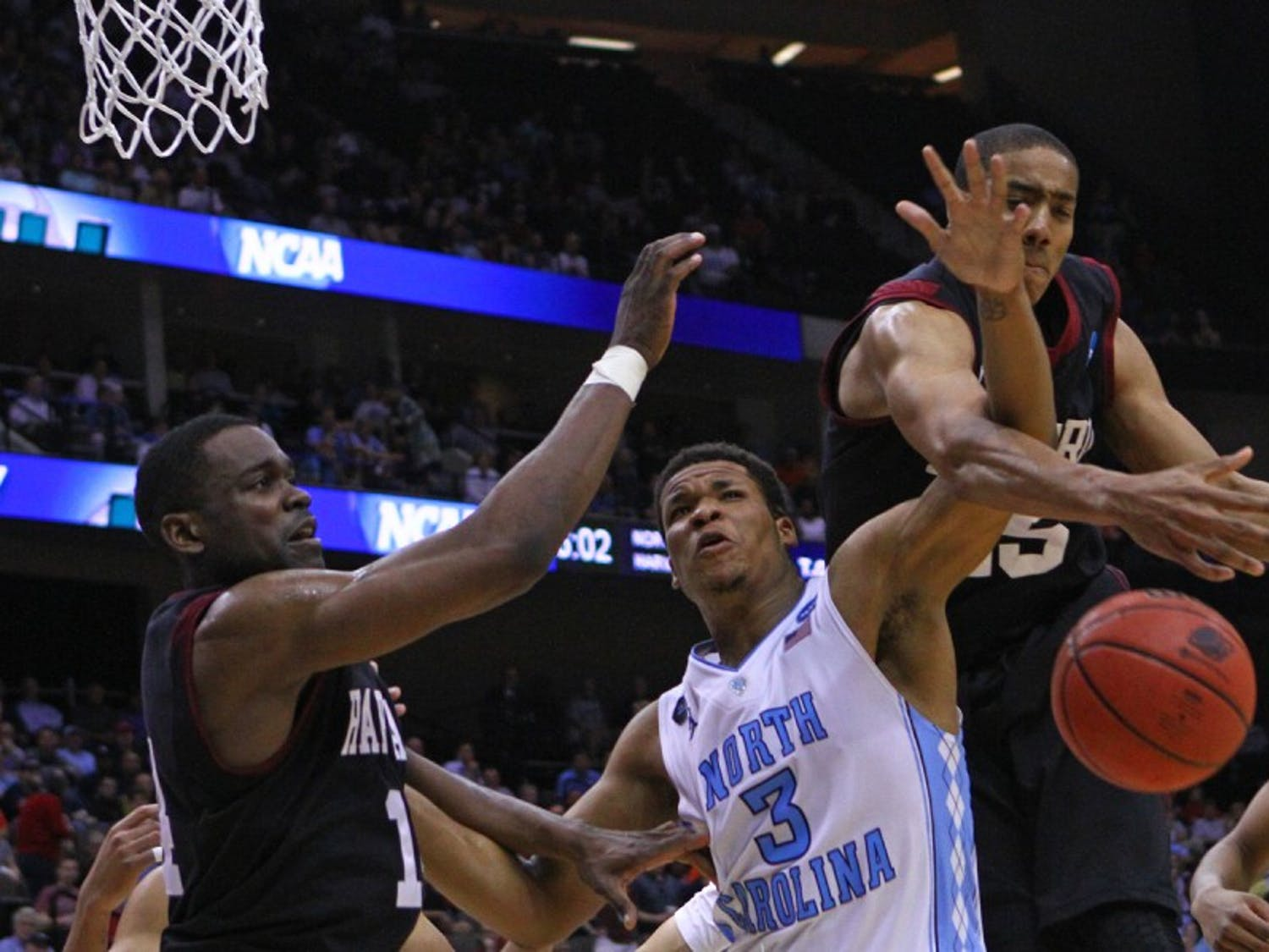 UNC forward Kennedy Meeks (3) gets tangled up with Harvard playersThursday in Jacksonville, Fla.