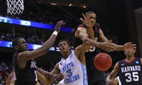 UNC forward Kennedy Meeks (3) gets tangled up with Harvard players Thursday in Jacksonville, Fla.