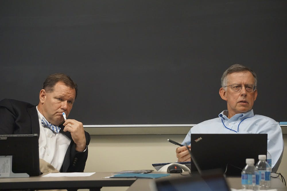 <p>Chair of the Faculty Bruce Cairns (left) and the new secretary of the faculty, Vincas Steponaitis (right), discuss how to best utilize the Faculty Executive Committee's meetings on Monday afternoon.</p>
