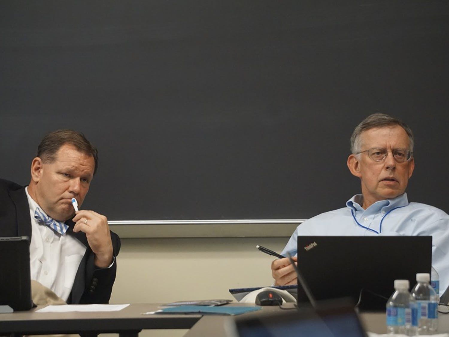 Chair of the Faculty Bruce Cairns (left) and the new secretary of the faculty, Vincas Steponaitis (right), discuss how to best utilize the Faculty Executive Committee's meetings on Monday afternoon.