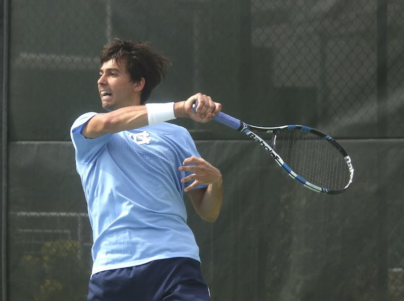 Andrew Gores returns a volley during the UNC team's victory over Clemson.