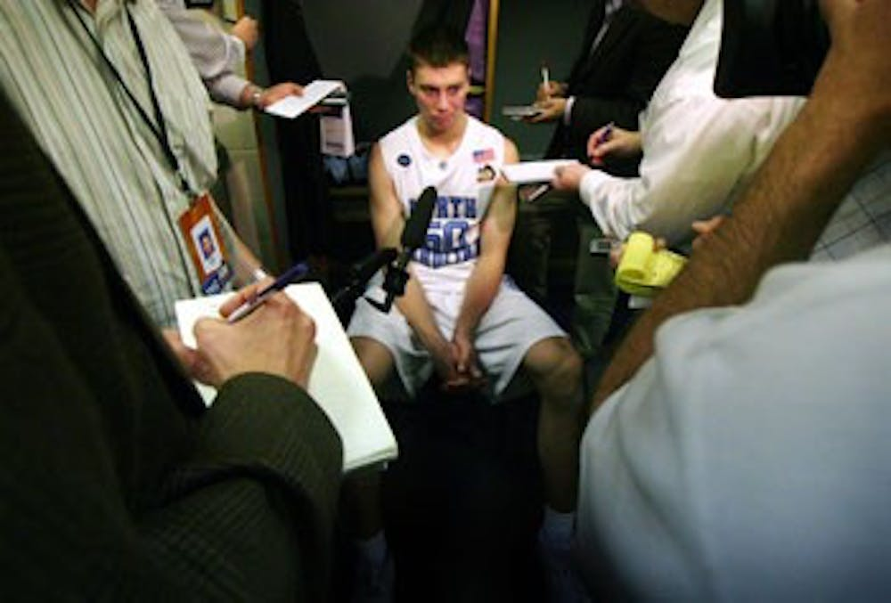 Tyler Hansbrough talks to reporters after an 84-66 loss to Kansas in the 2008 Final Four. No. 50 holds countless UNC records but has yet to win a title.
