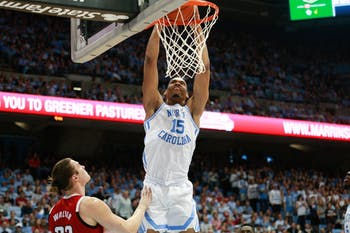 Sophomore forward Garrison Brooks (15) dunks during UNC's 113-96 win at the Smith Center on Tuesday, Feb. 5, 2019.