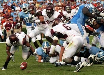 "Though Virginia Tech?s defense struggled early"" the Hokies? unit shut down the Tar Heels when it mattered most.VT forced two North Carolina fumbles both of which Virginia Tech recovered. UNC now is 0-5 against the Hokies since the school joined the ACC in the 2004 expansion."