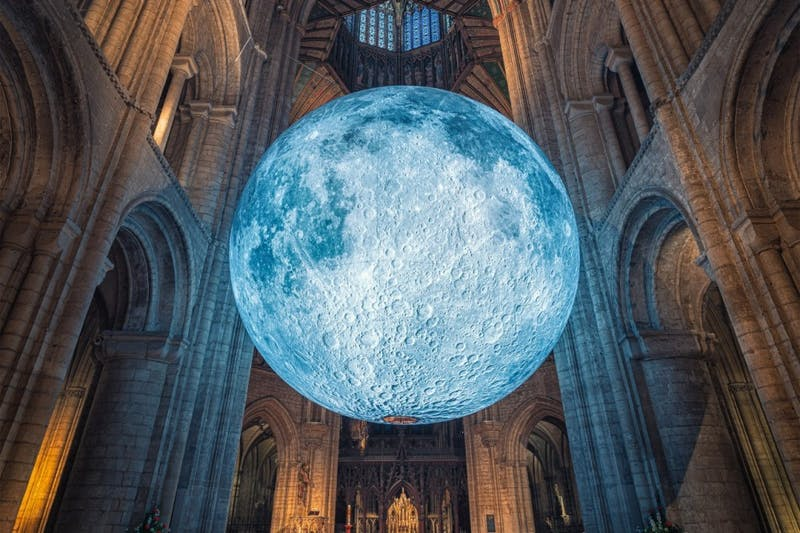 "A replica of the moon will hang over Durham starting on Oct. 31 with ""Museum of the Moon,"" an art exhibit by Luke Jerram. Photo courtesy of Bull Moon Rising."